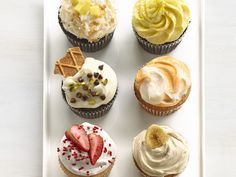 """50 Cupcakes : Food Network - FoodNetwork.com. High up on the """"oh, I really don't need that but totally do"""" list. 50 cupcakes, ranging from traditional to out there."""