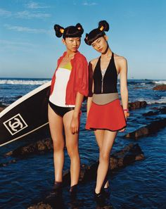 These girls are so fricken spunky. love the chanel surfboard
