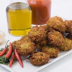Chef Michael Skibitcky tweaked this Joan Nathan recipe         , deleting the cilantro and adding ground coriander. For an authentic Israeli presentation, load the just-fried balls into pita bread and top them with chopped veggies, pickles, harissa hot sauce, and piquant tahini sauce.
