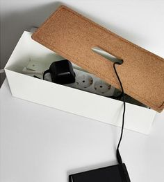 IKEA offers simple boxes for extension cords, finished off with a lid made of cork