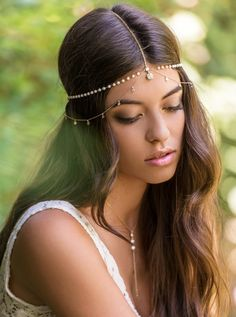 Turn heads with this delicate and stunning headpiece. This beautiful hair chain is handmade in New York City.