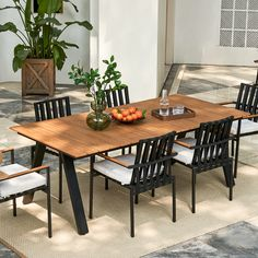 The Sorrento outdoor dining table pairs beautifully with its matching         dining chair to serve a dynamic contrast of beige and black tones, with         gorgeous teak details nodding to the allure of nature. Outdoor Dining Furniture, Outdoor Dining Set, Dining Area, Backyard Furniture, Backyard Patio, Dining Chair, Diner Table, Modern Outdoor Living, Home Decor Kitchen