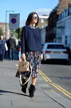 Anisa Sojka styles Yumi navy blue owl and flower printed midi skirt, shirt and knit sweater | Black suede Daniel Footwear ankle fringe stiletto boots | Beige 3.1 Phillip Lim mini pashli cross-body bag | Black double layer sunglasses with flaps | Fashion blogger street style shot in London by David Nyanzi.