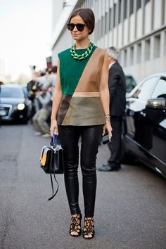 STREET STYLE SPRING 2013: MILAN FW - Miroslava Duma keeps leather leggings September-ready with strappy sandals and a color-blocked shell.
