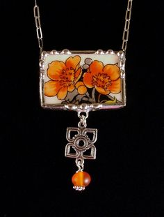 Art Nouveau poppies firey red orange necklace made from a broken plate by Dishfunctional Designs.