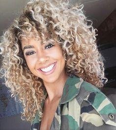 Blonde medium length naturally curly hair