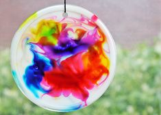 Cosmic glue suncatchers- made with glue and food coloring.