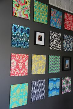 A single fat quarter stapled to craft store canvases.... love the bright colors against dark wall.