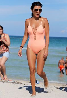 Kourtney Kardashian Shows Off Her Toned Bum in a Cheeky Pink Bathing Suit from InStyle.com