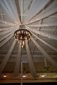 Home-made mason jar chandelier! (Ceiling at Indigo Falls for Jamie) decor Ceiling Draping, Ceiling Decor, Prom Decor, Reception Decorations, Contemporary Rustic Decor, Wedding Ceiling, Mason Jar Chandelier, Prom Themes, Barn Parties