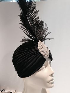 Black feather turban -Cosplay-black Headpiece- Feather 20s Stretch Headdress- flapper headband- black head wrap-1920s Great Gatsby handmade in USA Hello, Im shipping within 1 business day. First class shipping can take up to 5 days. For a little bit more priority mail gets there in 3 days in the U.S. Stand out in the crowd with stunning 1920s headpiece...Youll be one of the best dressed at the party! This black and silver rhinestone feather turban is made with a black Ostrich feather tha...