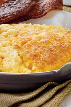 Cheddar Cheese Grits Casserole - 101 Best Comfort Food Classics - Southern Living - Recipe: Cheddar Cheese Grits Casserole This eggs, cheese, and grits combination is simple but absolutely delicious, and a true Southern favorite. Cereal Recipes, Casserole Recipes, Breakfast Dishes, Breakfast Recipes, Breakfast Ideas, Breakfast Casserole, Brunch Ideas, Morning Breakfast, Grits Breakfast