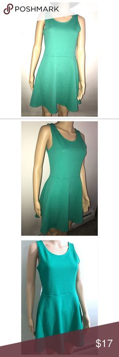 NWT Green Textured Stretch Skater/Baby Doll Dress New with tags super cute dress. Size 10 dress. Stretchy dress and comfortable fabric. Great choice for the holidays! Flowy and cinched at the waist. Great for dancing and can be causal of dressed up with accessories. Great price. Bundle and save! Dresses