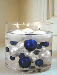 so pretty with blue and silver baubles and round floating candles!