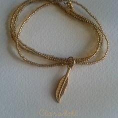 """Bracelet en perles de rocailles """"désert et plume""""  or"""