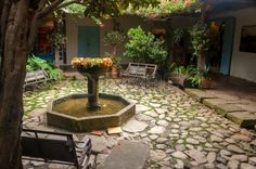 Beautiful old fountain in a colonial courtyard in Villa de Leyva, Colombia. Stock Photo - 16558404