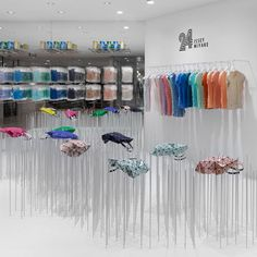 24 Issey Miyake Shop at Shibuya Parco by Nendo (accessories displayed atop clusters of steel rods)