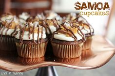 Samoa Cupcakes from Chef in Training; how to make yummy desserts out of girl scout cookies Köstliche Desserts, Delicious Desserts, Yummy Food, Dessert Healthy, Plated Desserts, Cupcake Recipes, Cupcake Cakes, Dessert Recipes, Cupcake Ideas