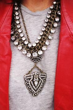 great combo...statement necklaces amd red blazer with grey t-shirt - great street fashion