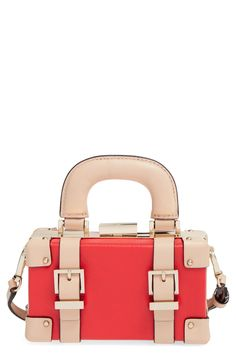 Vintage, steam-trunk straps and polished golden hardware lend trend-right style to this diminutive luggage-style crossbody bag that's ideal for the modern-day globetrotter.