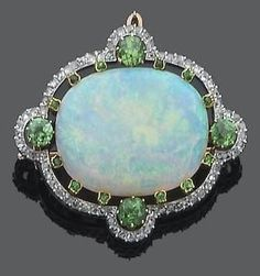 An opal, demantoid garnet and diamond brooch, Ca. 1900 The oval cabochon opal within a pierced circular-cut demantoid garnet surround and a rose-cut diamond border, mounted in silver and gold, French