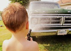 Washing his cousin's Ford