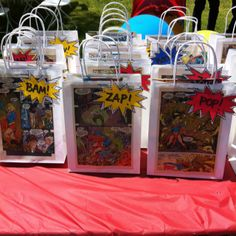 Goodie bags for my sons superhero birthday party.  Bought the bags from the dollar store, used comic book pages as the decoration.  Then I made the pow signs using PowerPoint and scrapbook paper