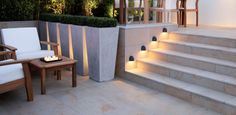 up lighting behind Box planters and down lighting on steps
