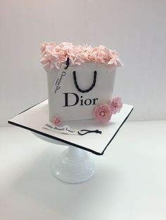 Fondant Dior shopping bag cake with sugar flowers by Frost It Cakery
