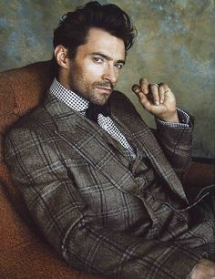 Hugh Jackman, three piece suit, bow tie and scruffy.
