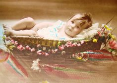Vintage hand tinted April Fool's RPPC of a baby floating in a basket on the water. #vintage #April_Fools_Day #fish #postcards