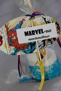Marshmallow favors for Superhero parties. Made with large camp-fire marshmallows dipped in white chocolate, and then covered in blue sanding sugar.