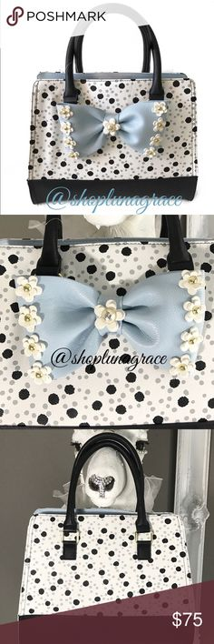 "Just In🦋 Betsey Flirty Floral Dots Satchel This bag is so cute! Creamy white with soft gray & black dots, black bottom & handles. Blue bow trimmed in white layered flowers & pearl Betsey button in center. Inside center zip compartment, back wall zip pocket & front wall 2 slip pockets. Handles have 5"" drop. Large center snap closure. NWT Betsey Johnson Bags"