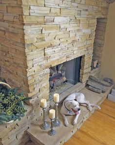 "this stacked ""stone"" fireplace and hearth are the exact ones I want for the living room. But I would add a reclaimed wood mantle"