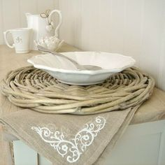 Willow placemat, embroidered napkin, fluted bowl