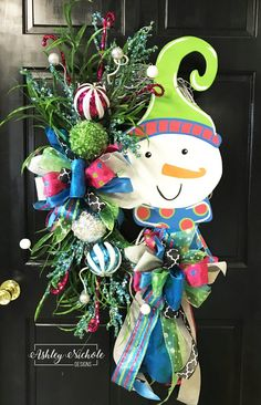 This colorful snowman wreath is so cheery! Hang it during the holidays or all winter long! Built on a 24 white oval grapevine wreath. Approximately: Approximately - 21 Wide x 30 Tall Christmas Door Wreaths, Christmas Star, Christmas Gift Tags, Holiday Wreaths, Christmas Crafts, Christmas Decorations, Christmas Ornaments, Country Christmas, Mesh Wreaths