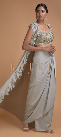 Fog Grey Crop Top And Skirt With A Matching Sleeveless Jacket With Ruffles Online - Kalki Fashion Sleeveless Jacket, Sleeveless Crop Top, Grey Crop Top, Crop Tops, Mehendi, Traditional Outfits, Indian Outfits, Pakistani, Ruffles