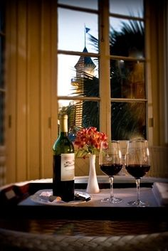 Nothing like a striking view of the Jekyll Island Club Hotel turret out your hotel window! And a nice bottle of wine. www.jekyllclub.com #jekyllisland #jekyllclubsummer