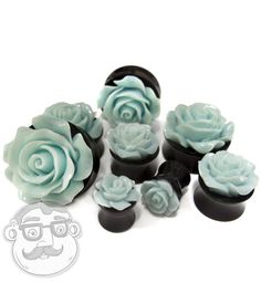 Pair of Mint Green Rosebud Black Plugs / Ear Gauges Double Flare 0G - 1 inch (ordering a quantity of 1 gets you a pair)  Select size from the drop-down menu  Material: Acrylic  Double Flares  Sold in Pairs  Pick from 0G, 00G, 1/2(12mm), 9/16, 5/8, 3/4, 7/8, 1 Inch
