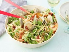 Giada's simple Spaghetti with Pinot Grigio and Seafood gets vibrant color from sun-dried tomatoes, fresh arugula and pink, tender shrimp.
