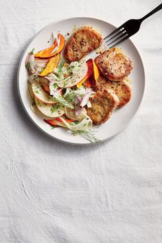 "Pork Medallions with Fennel-Apple Slaw | ""Sliced pan-seared pork tenderloin teams up with a crisp apple-fennel slaw in this comforting weeknight dinner that's perfect for fall. The simple pan sauce, which features apple cider and two types of mustard, adds brightness and balance to this cozy meal. "" #porkrecipes #porkdishes #pork"