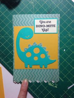 'You are Dino-mite' Cute Mother's Day card from grandchildren to grandmother. Created dinosaur cutout using a Cricut machine and different colors of paper to layer. The fun striped dotted green paper was pre-cut in that shape purchased from Michael's. Great DIY greeting card project or Request custom order at www.papertechie.com