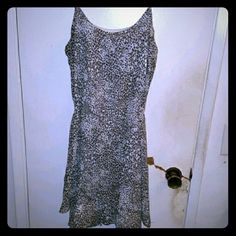 Bisou Bisou Cheetah print dress Super comfortable dress. Has a white under layer, adjustable straps, and a tie that can tie at the back or on the side. Super cute dress to wear during the day or cute to dress up with a jacket and nice shoes. Only been worn once, no flaws or damage. Bisou Bisou Dresses Mini