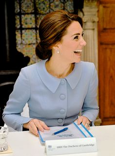 The Duchess of Cambridge laughs as she prepares to convene a round-table discussion on the themes of addiction, intervention, family and mental health on her trip to the Netherlands.