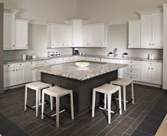 This kitchen's white cabinetry and Blue Flower granite island produces a beautiful contemporary contrast.