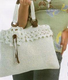 Magnifica borsa all'uncinetto realizzata con punto basso e rifinita sulla parte superiore con un bordo e un fiore al punto peruviano. fonte:dal web
