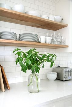 Wood Kitchen Shelves & White Backsplash