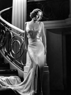From  the  staircase to that dress,  this shot is on point! Joan Crawford in Adrian gown, 1936
