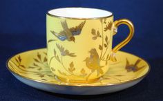 Both are decorated with gold and silver birds and flowers on a bright yellow background in the Aesthetic Movement style. Description from rubylane.com. I searched for this on bing.com/images