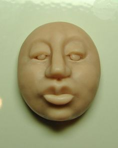 How to Shape a Polymer Clay Face Cabochon: A Free Tutorial by Dottie Hoeschen